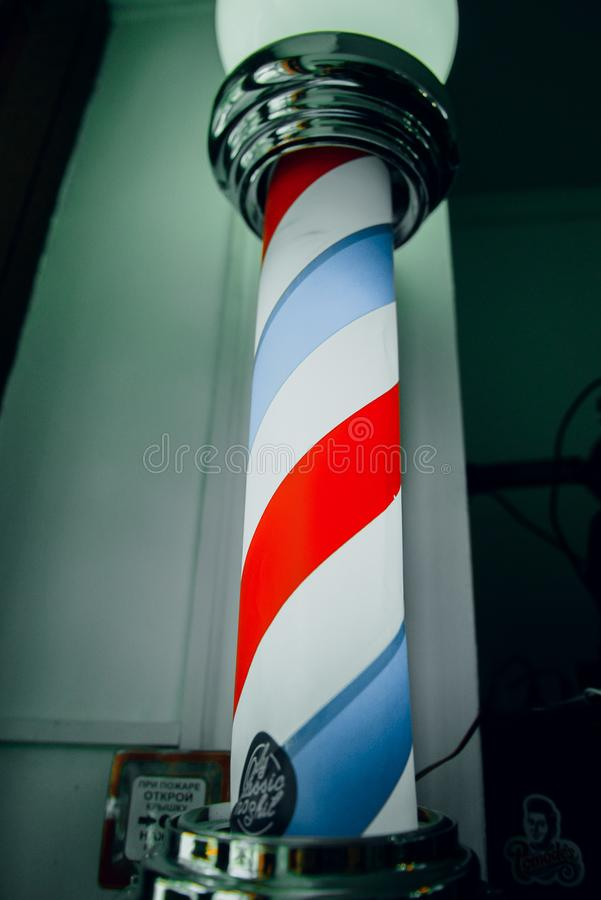 Old fashioned vintage glass Barber Shop pole with Barber Sign. Fashioned vintage glass Barber Shop pole with Barber Sign, red, blue, pattern, white, symbol stock photo