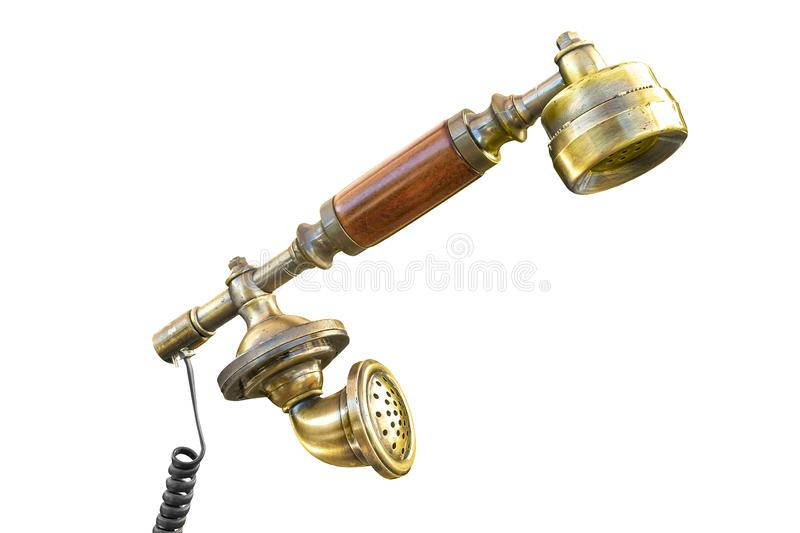 Old fashioned vintage telephone receiver with wire. Close up of a retro vintage phone receiver on a white background with path included stock images
