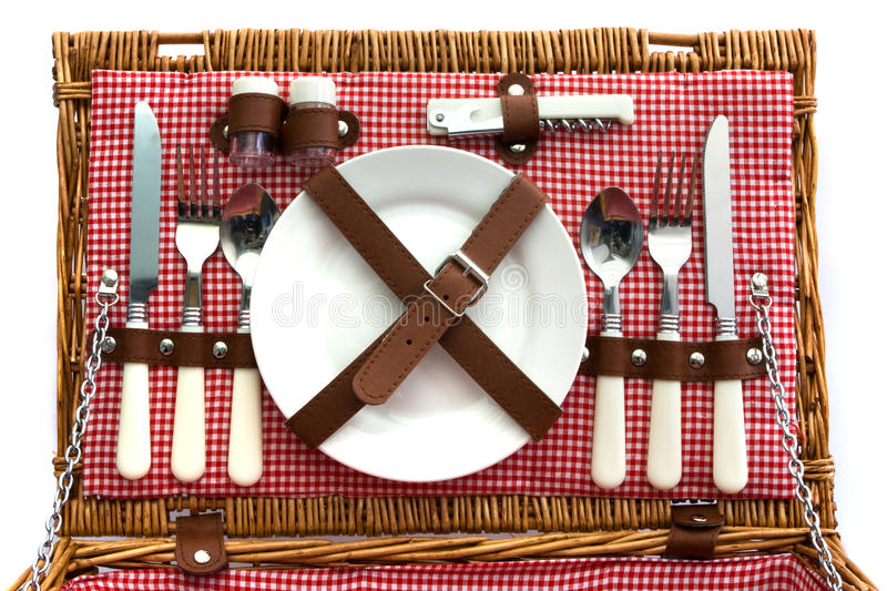 Old Fashioned Wicker Picnic Basket With Cutlery Stock Photo