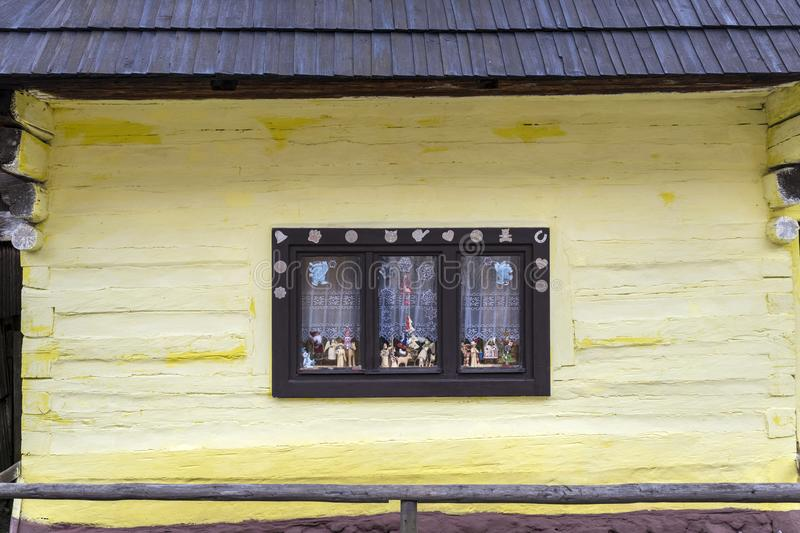Old-fashioned window of wooden house in Vlkolinec stock image