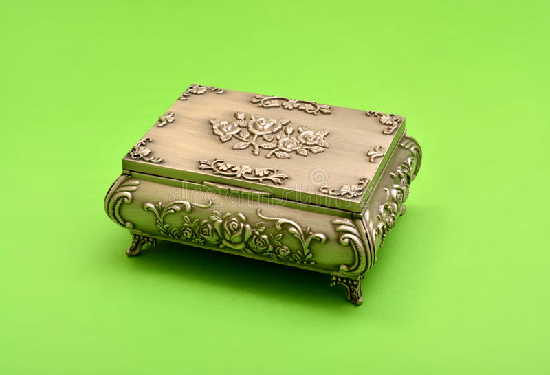 Old fassioned treasure box isolated on green background stock images