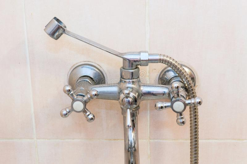 Old faucet the faucet Assembly in the bathroom. Limescale on chrome taps and mixer shower stock image