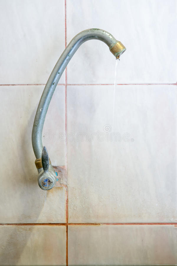 Old faucet leak in bathroom stock photography