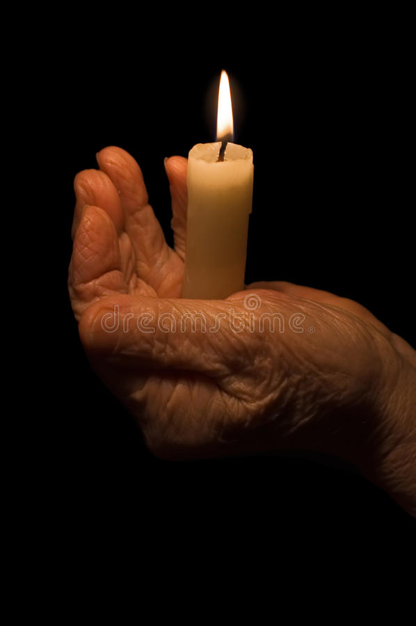 Old Female Hands With A Candle Royalty Free Stock Photos