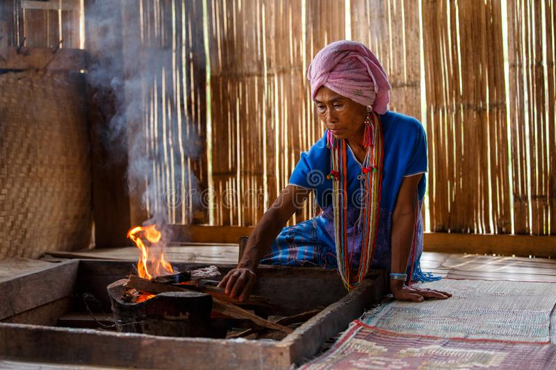Old female karen hill tribe is cooking traditional in the cottage of northern Thailand at Mae Klang Luang royalty free stock photos