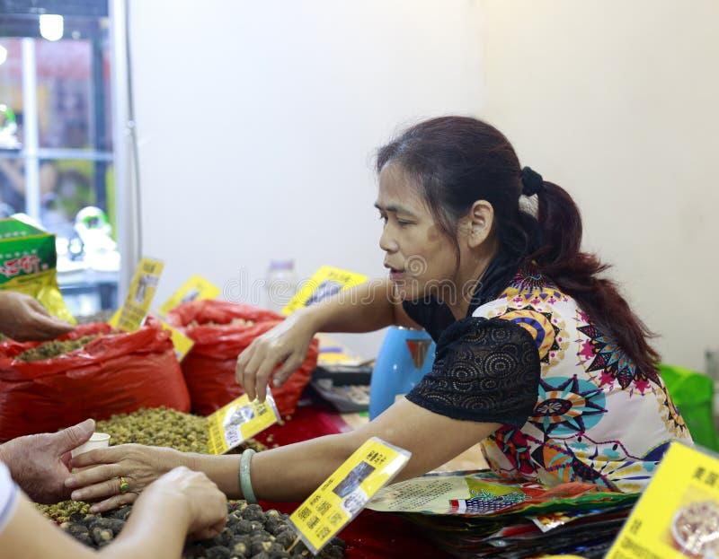 Old female vendors selling chinese herbal tea, adobe rgb stock image