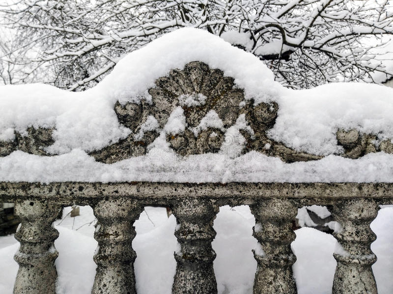 An old fence covered with snow stock image