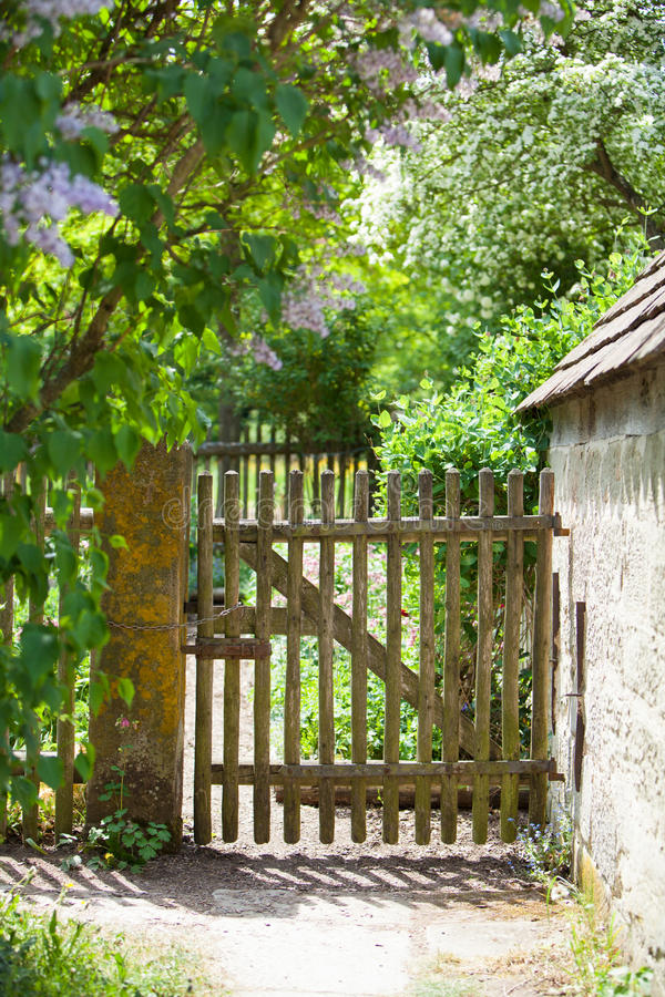 Old fence and gate to a cottage garden stock photos