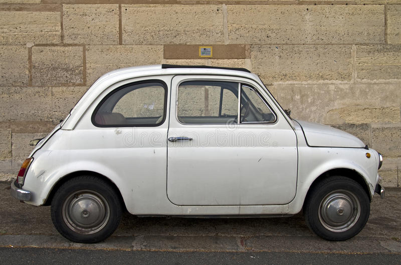 Old Fiat 500. Old white Fiat 500 on Paris street royalty free stock image