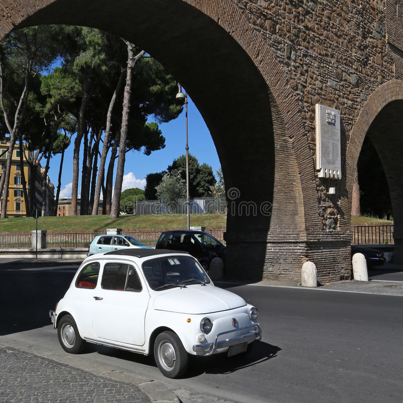 Old Fiat 500 in Rome. An old Fiat 500 parked in Rome royalty free stock images