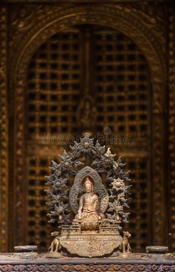 Old figurine of Buddha against the background of gate temple. stock photos