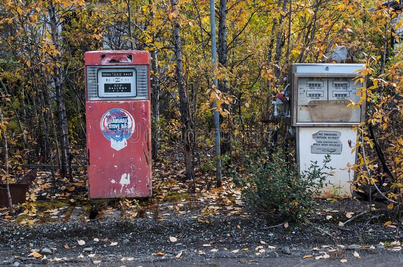Old filling station, Witnesses of former times - Historic petrol pumps, Yukon, Canada stock images