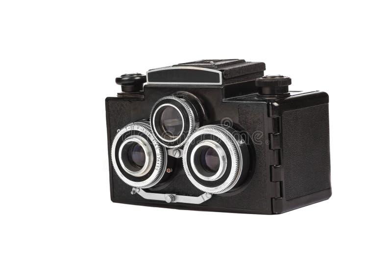 Old film camera isolated on white. Retro vintage film camera on white background royalty free stock photo