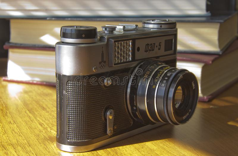 Old film camera on the table royalty free stock photo