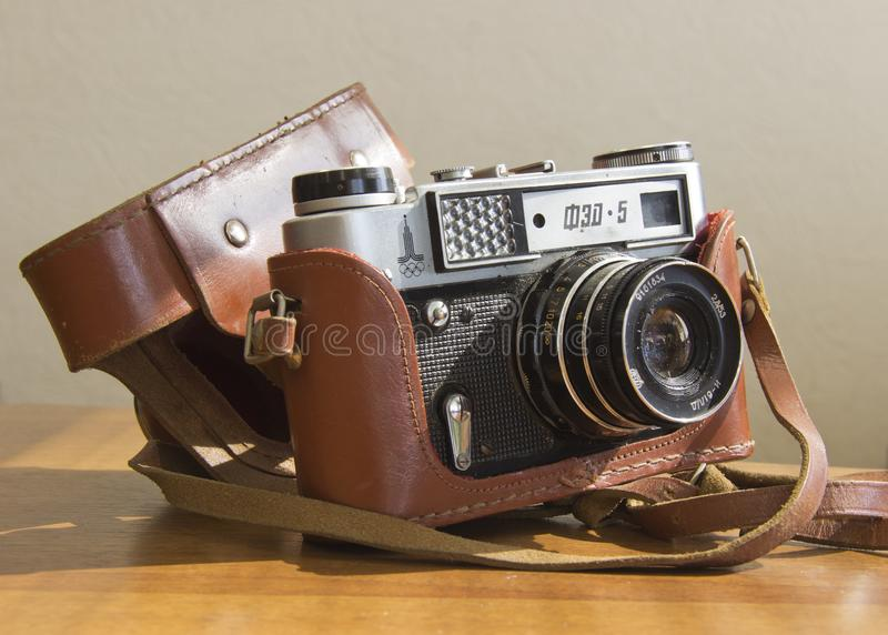 Old film camera on the table royalty free stock images