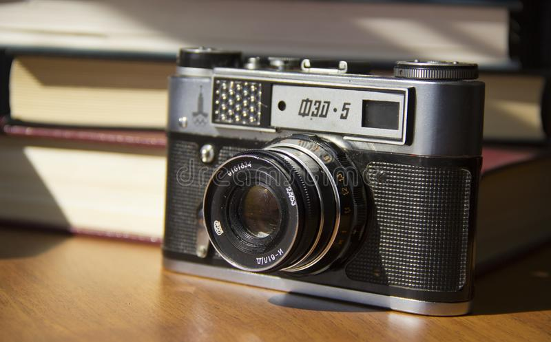 Old film camera on the table stock image