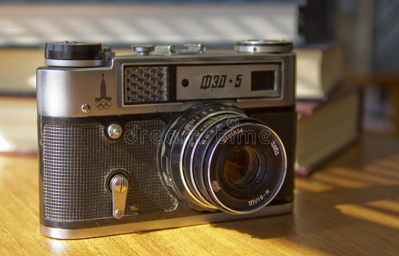 Old film camera on the table royalty free stock photos