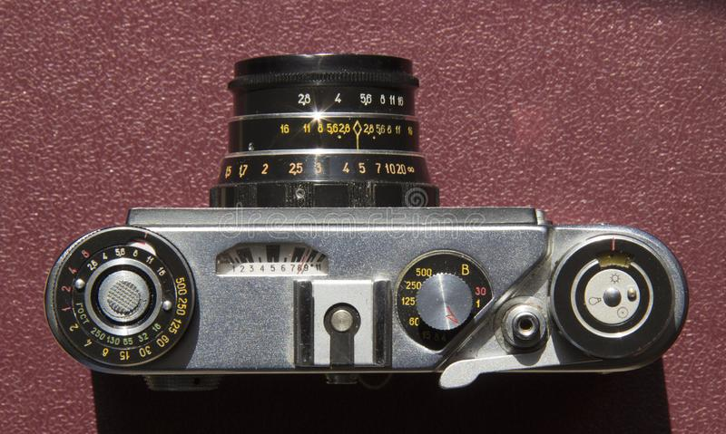 Old film camera on the table royalty free stock image
