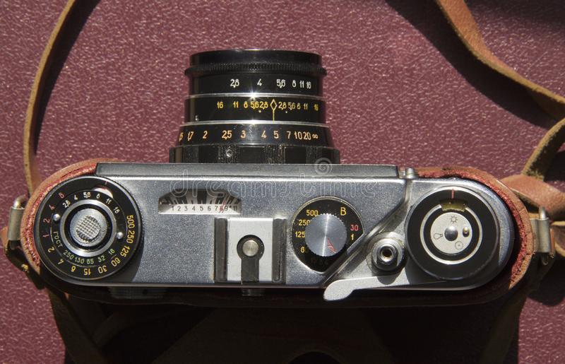 Old film camera on the table royalty free stock photography