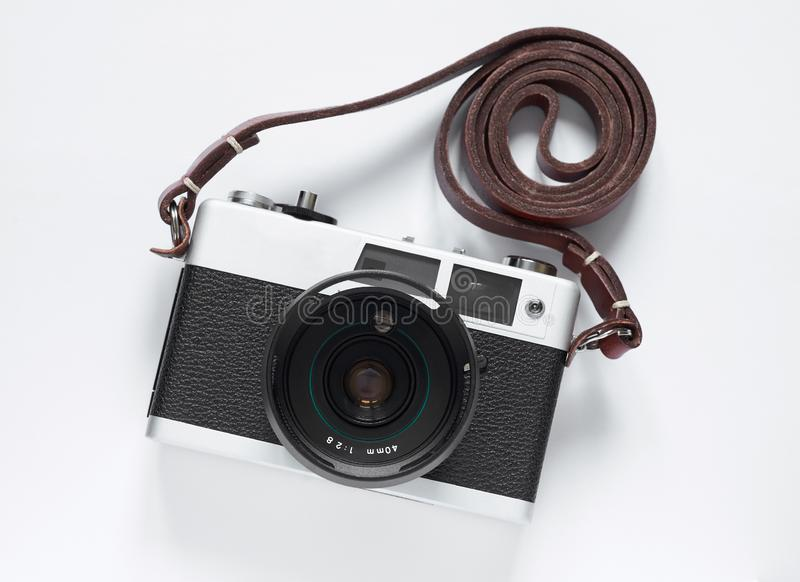 Old film camera. White background close-up. Vintage photo royalty free stock photography