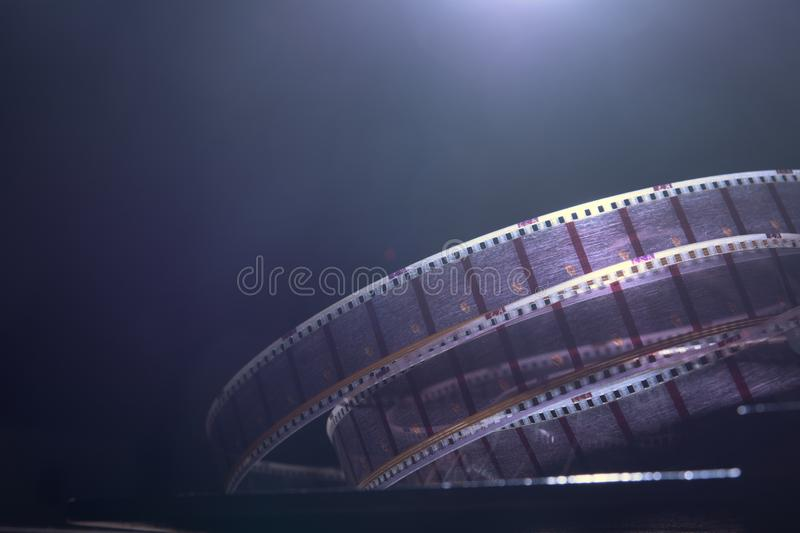 Old film with a movie on a dark background.  stock photography