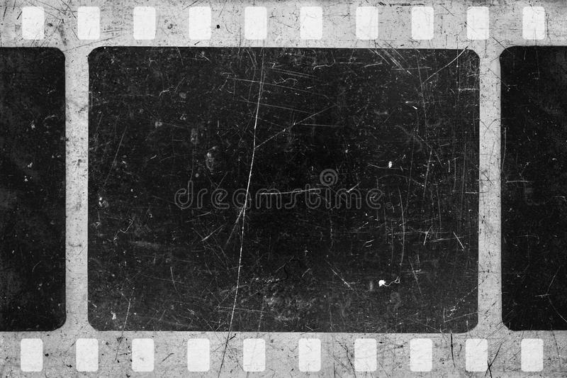 Old film. Old scratched and damaged grungy negative film royalty free stock photos