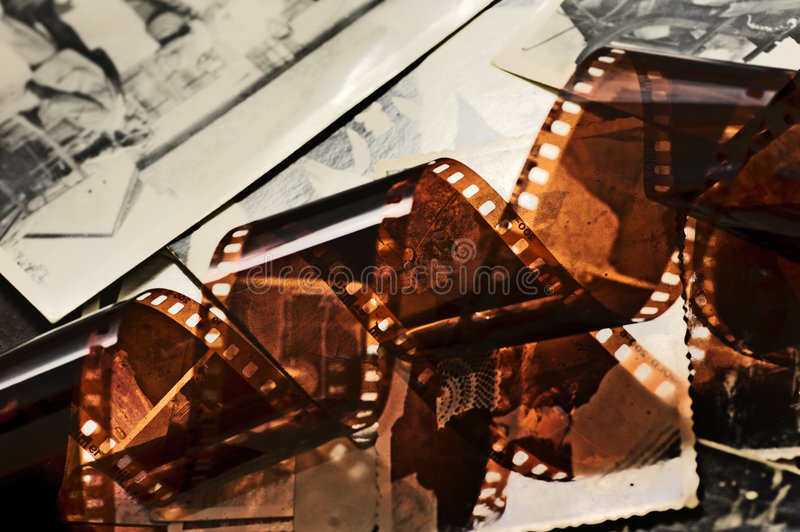 Old film strip and photos background royalty free stock image