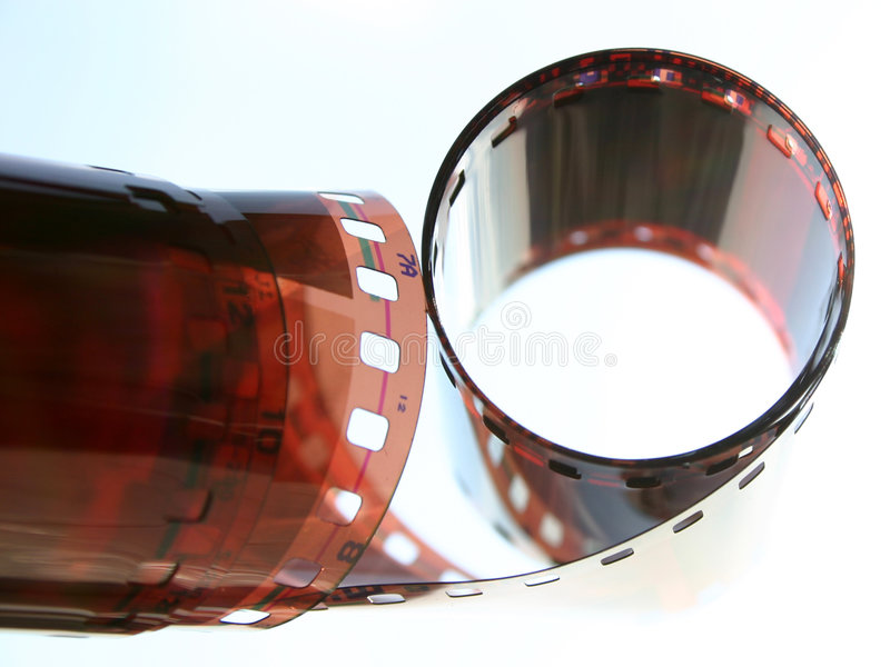 Old filmstrip. Partially rolled, close-up royalty free stock photo