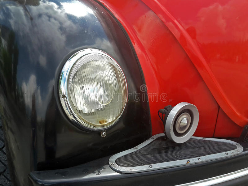 Old fire department van, detail. Headlight of an old red and black fire department vehicle stock photography