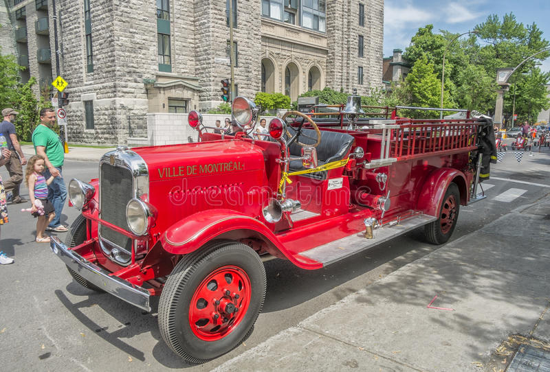 Old fire truck. Street fair in Little Italy, Montreal. Little Italy French: La Petite-Italie; Italian: Piccola Italia is a neighbourhood in Montreal, Quebec stock photography