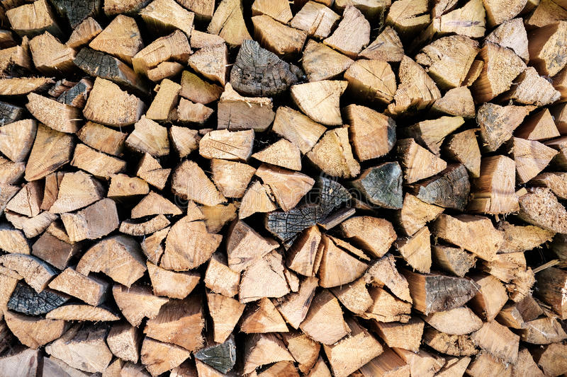 Old firewood stacked. Firewood stacked in a woodpile stock photos