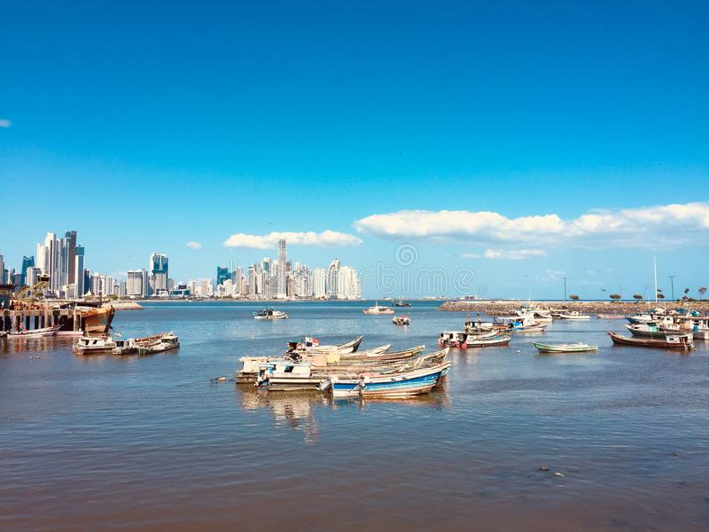 Old fisher boats and modern skyscraper skyline, Panama City royalty free stock photos