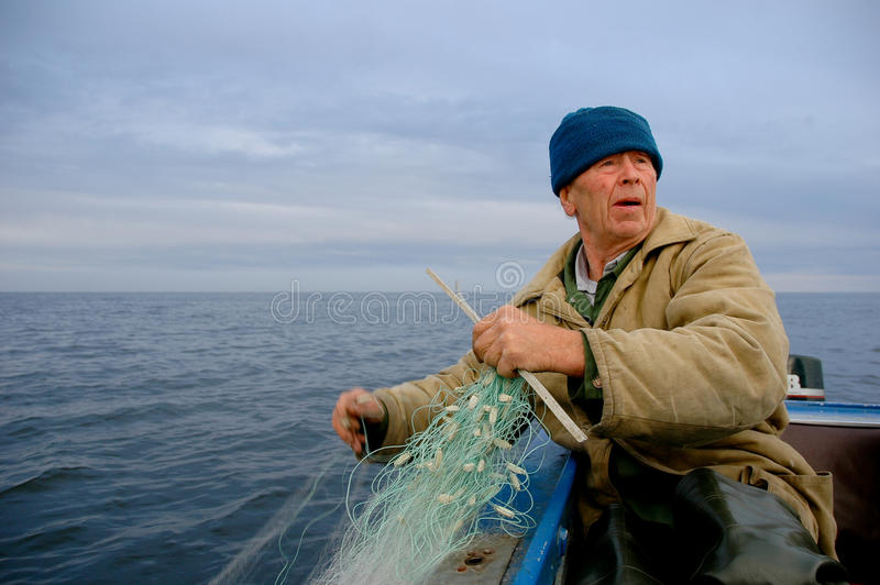 Old fisherman stock photos