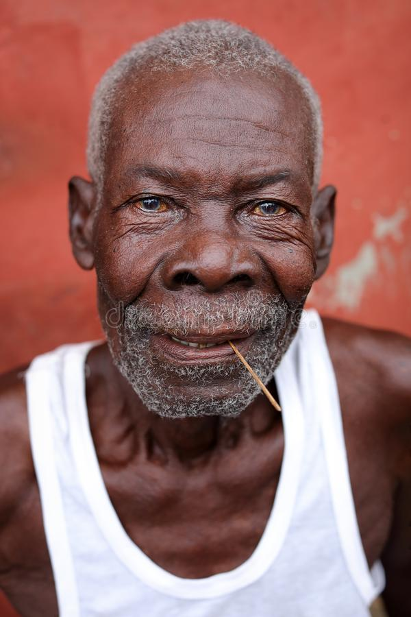 Old fisherman in Accra, Ghana. An old fisherman of the Ga people in the fishing village Jamestown in Accra, Ghana royalty free stock images
