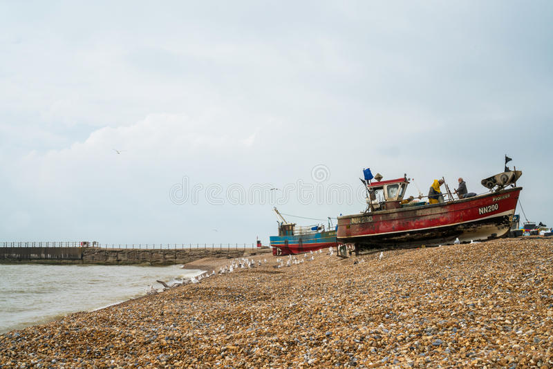 Old fishermans boats on seafront in Hastings old town stock photography
