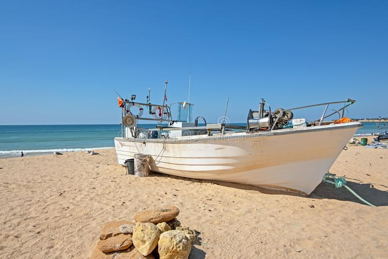 Old fishers boat on the beach in Armacao de Pera in the Algarve Portugal. Europe royalty free stock image