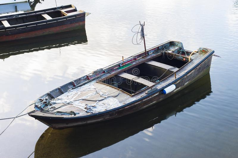 Old fishing boat anchored in Galicia stock images