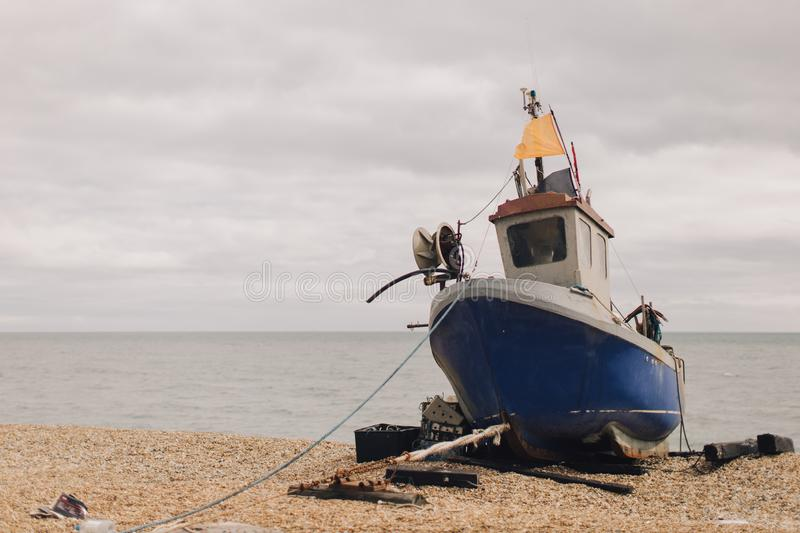 Old fishing boat docked on the beach royalty free stock photos
