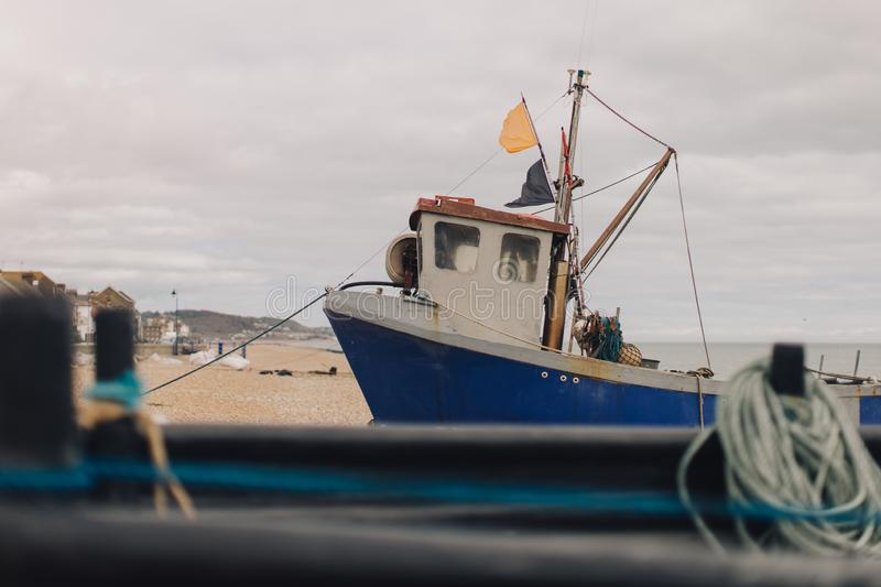 Old fishing boat docked on the beach royalty free stock photo