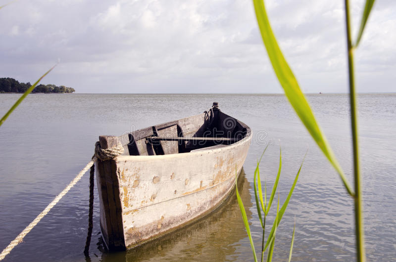 Old Fishing Boat Floating On Sea Water Stock Photo - Image: 33843860