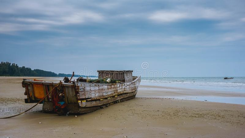 Old fishing boat. Mong Cai, Vietnam. Old fishing boat on the beach. Mong Cai, Vietnam. South East Asia royalty free stock photography