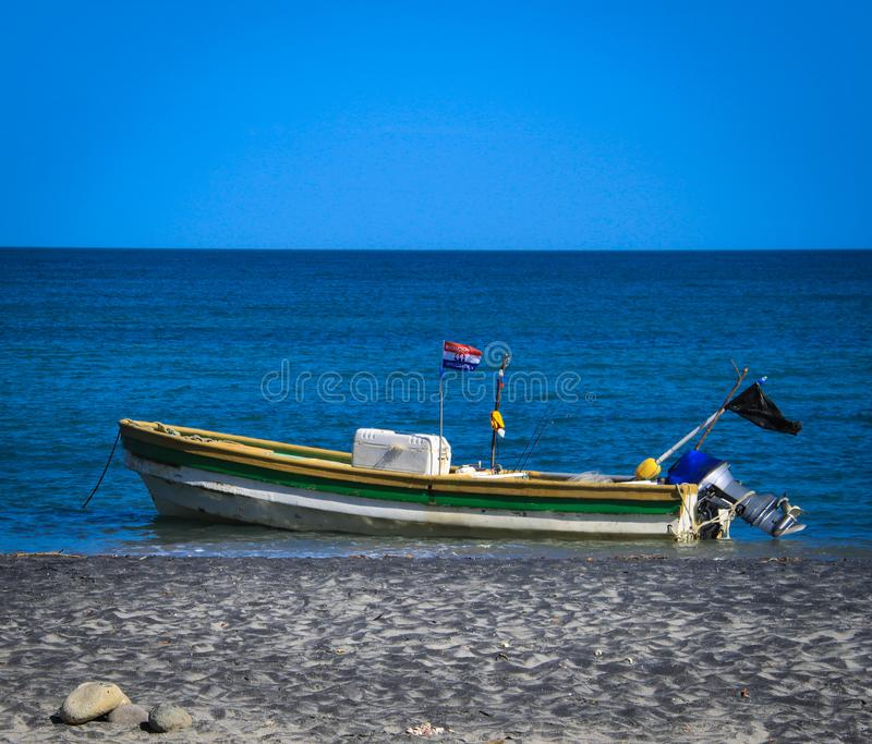 Old Fishing Boats On Beach: Lone Old Fishing Boat On The Beach Stock Image
