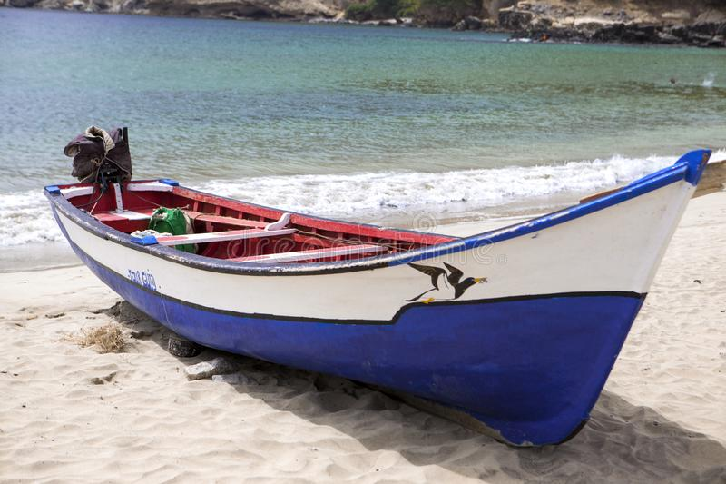 Old fishing boat on the shore. Boat with nets waiting for fishermen on the beach of Cape Verde royalty free stock image