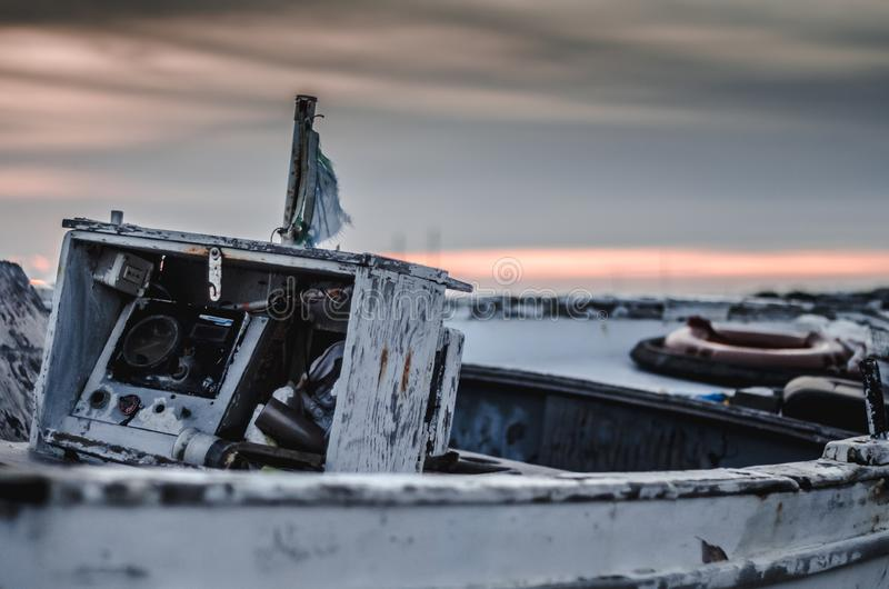 Old fishing boat on sunset royalty free stock images