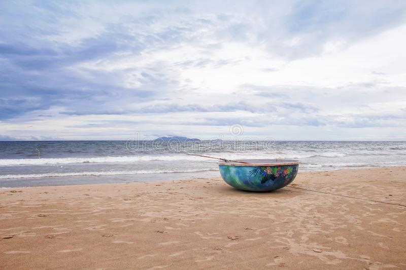Old fishing boats on sandy shore and evening beach landscape , sky in Danang city , Vietnam royalty free stock photos