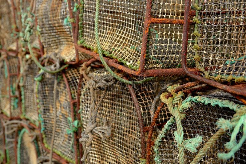 Old fishing cages. Fishing cages stacked, old and rusty stock photo