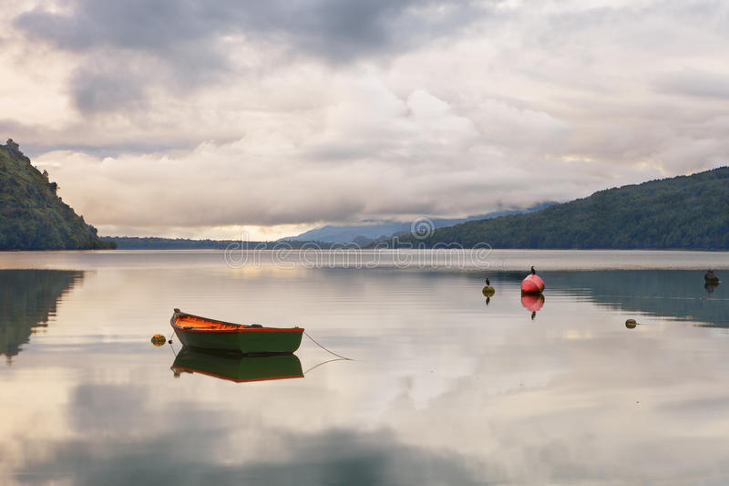 Old fishing craft anchored on the beach Puyuhuapi Fjord, Patagonia, Chile royalty free stock image