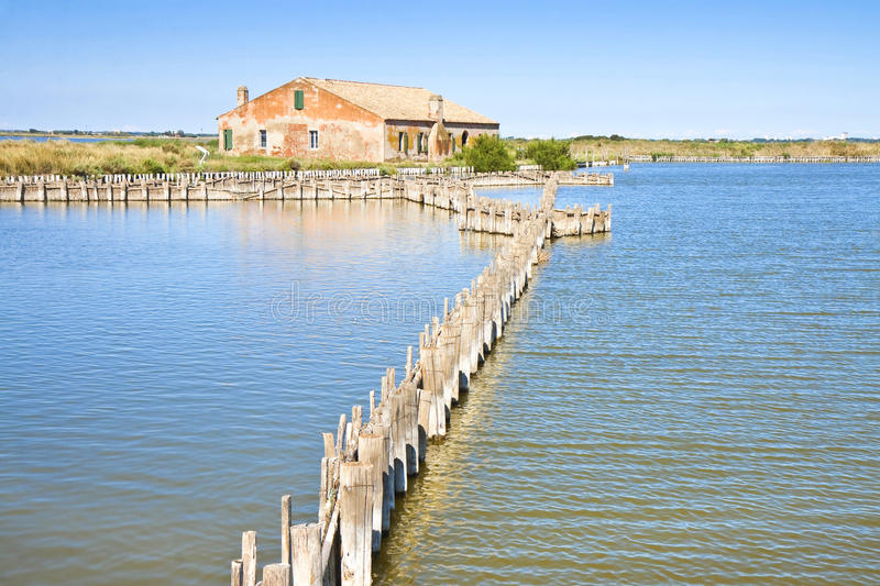 Old fishing home in the Comacchio's valleys. The Comacchio's valleys (Ferrara, Italy) are known worldwide for eel fishing - UNESCO protected area royalty free stock photo