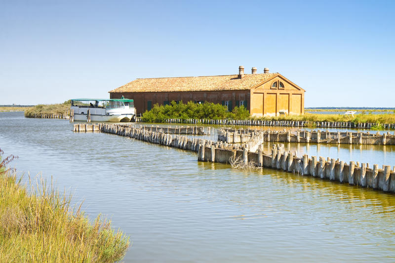 Old fishing home in the Comacchio`s valleys. The Comacchio valleys Ferrara, Italy are known worldwide for eel fishing - UNESCO protected area stock photography
