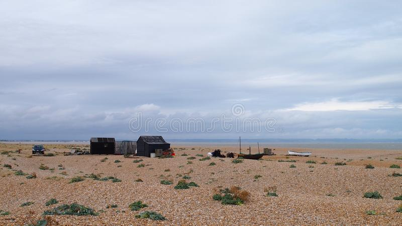Old Fishing Huts in Dungeness in Kent, Southern England. Dungeness is one of the biggest shingle beaches in Europe and has attracted many artists over the years royalty free stock photos